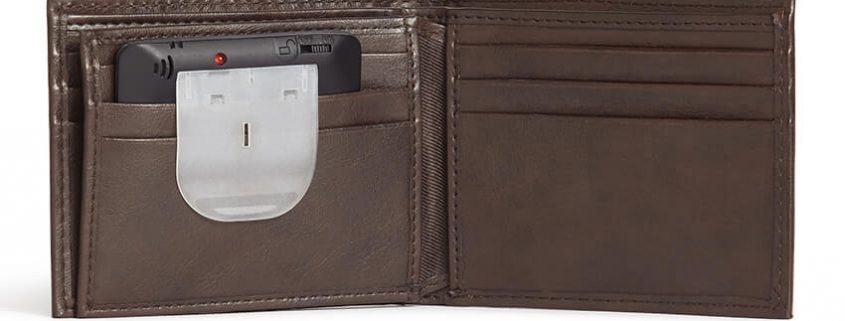 A slim security tag is shown inside the pocket of an open wallet.