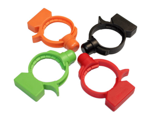 4 circular security tags in the colors orange, green, red, and black.