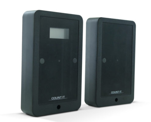 Count-It, 2 small black devices used as a retail traffic counting solution for fitting rooms.