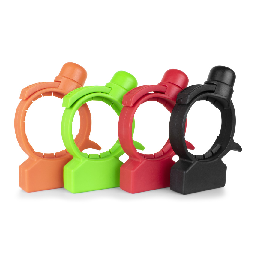 4 circular security attachments, 1 orange, 1 green, 1 red, and 1 black that are all tamper resistant.