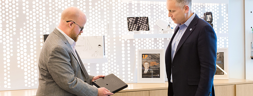 Tom Meehan and Rubin Press examining RFID technology in an innovation lab